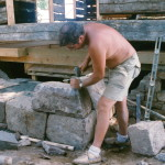 Shaping stone with hammer and chisel