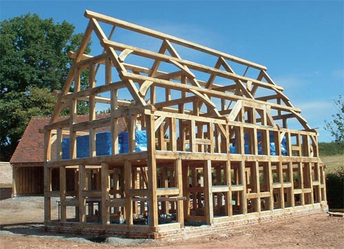 Green lumber on a new home handmade houses with for Alternative home building methods