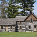 Another three-section log home
