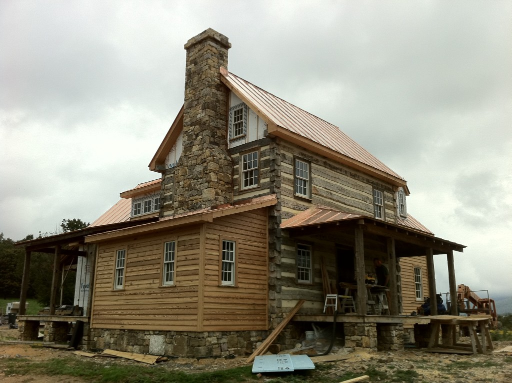 Handmade houses with noah bradley log cabins timber for Log homes with stone