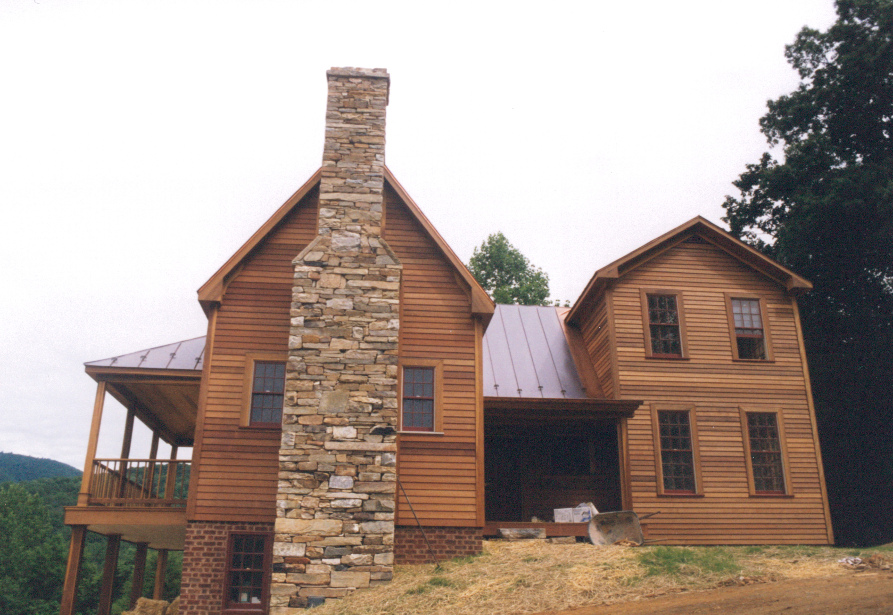 Houses With Stone Chimneys : Always build the chimney where it can be appreciated