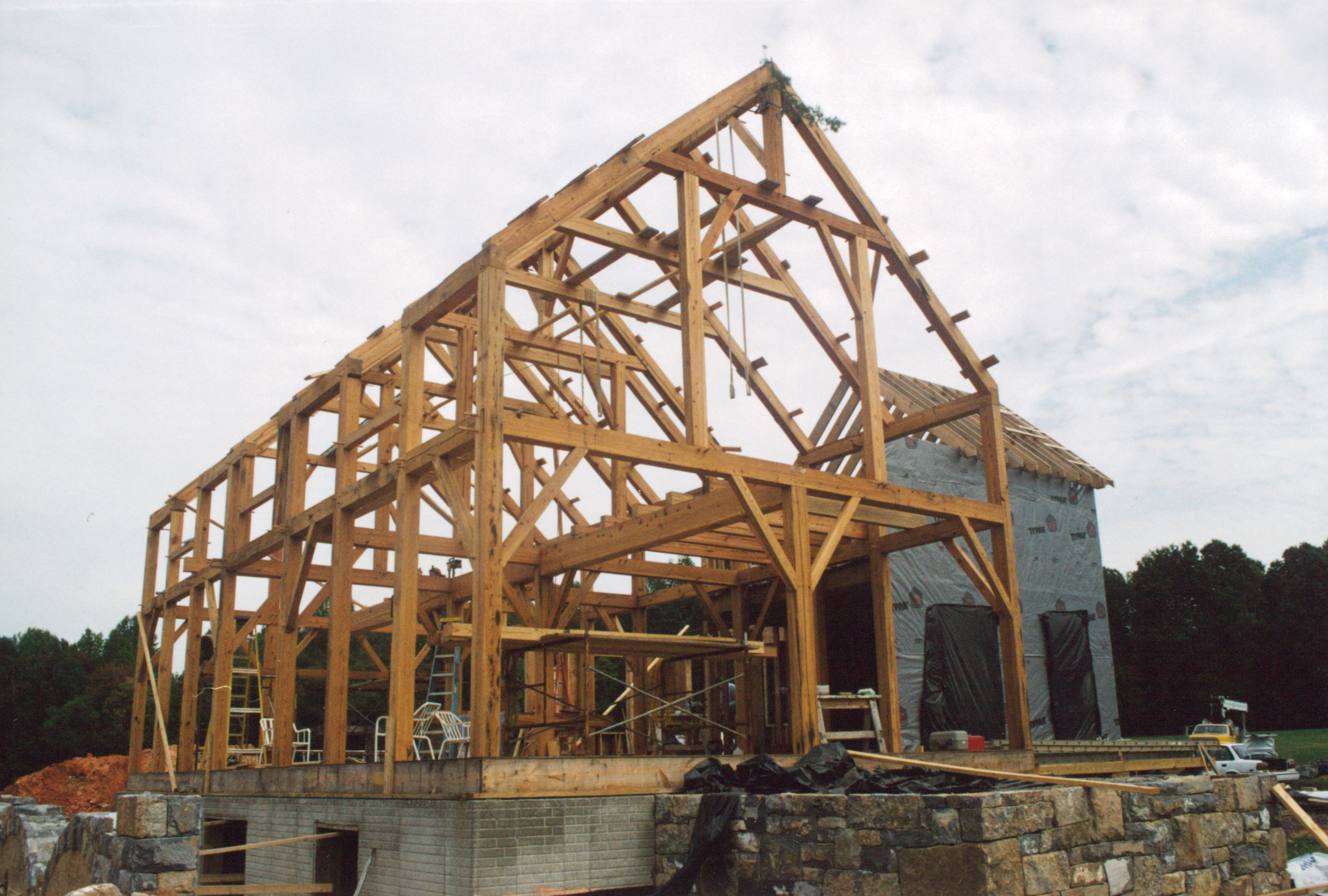 A completed heart pine timber frame barn handmade for Timber frame barn home plans