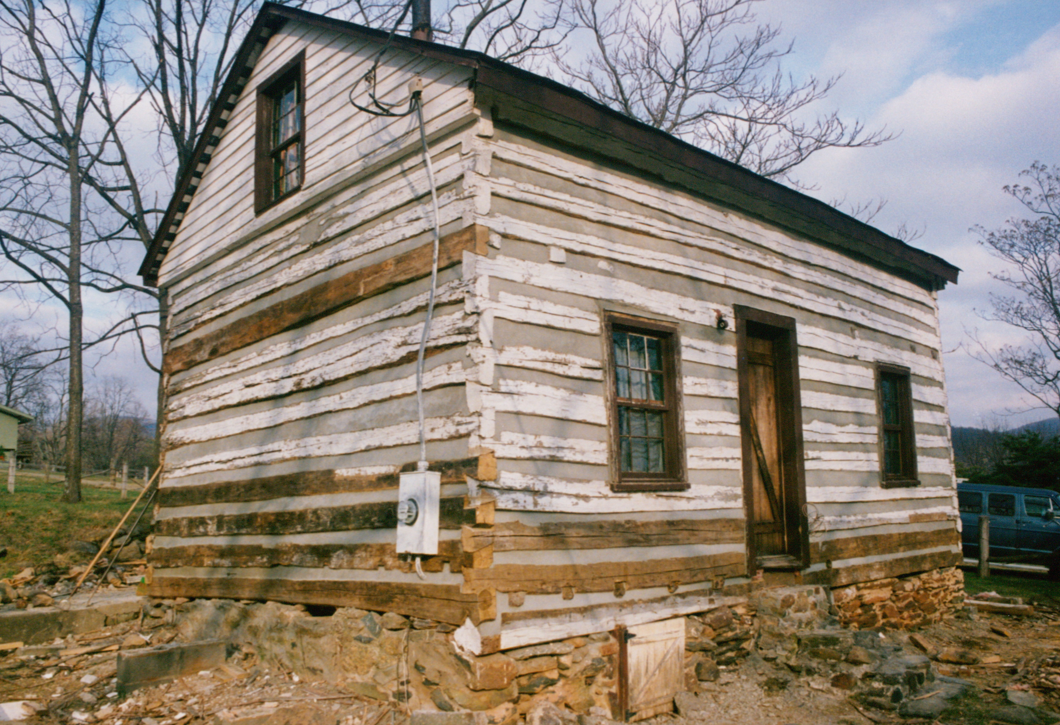 A log cabin repair part 3 handmade houses with for Log cabin restoration