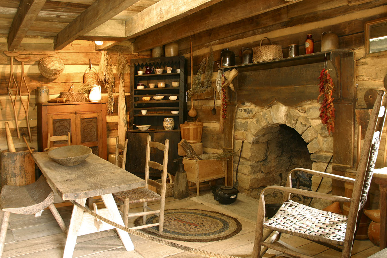 old stone fireplace. Arched stone fireplace in an old log cabin  Handmade Houses with