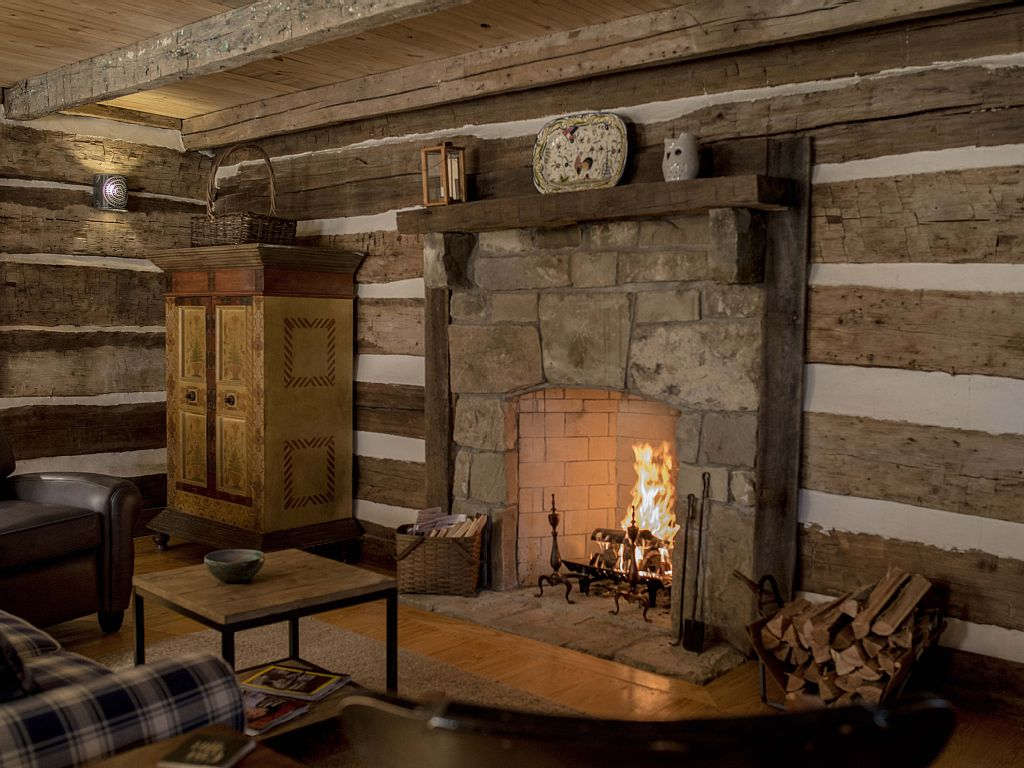A log cabin interior critique handmade houses with for Cabin fireplace pictures