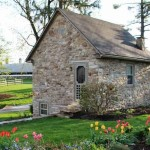 A stone cottage in a pastoral setting