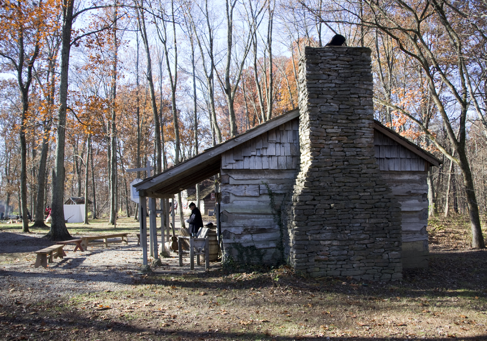 A stone chimney with a log cabin handmade houses with for Log homes with stone