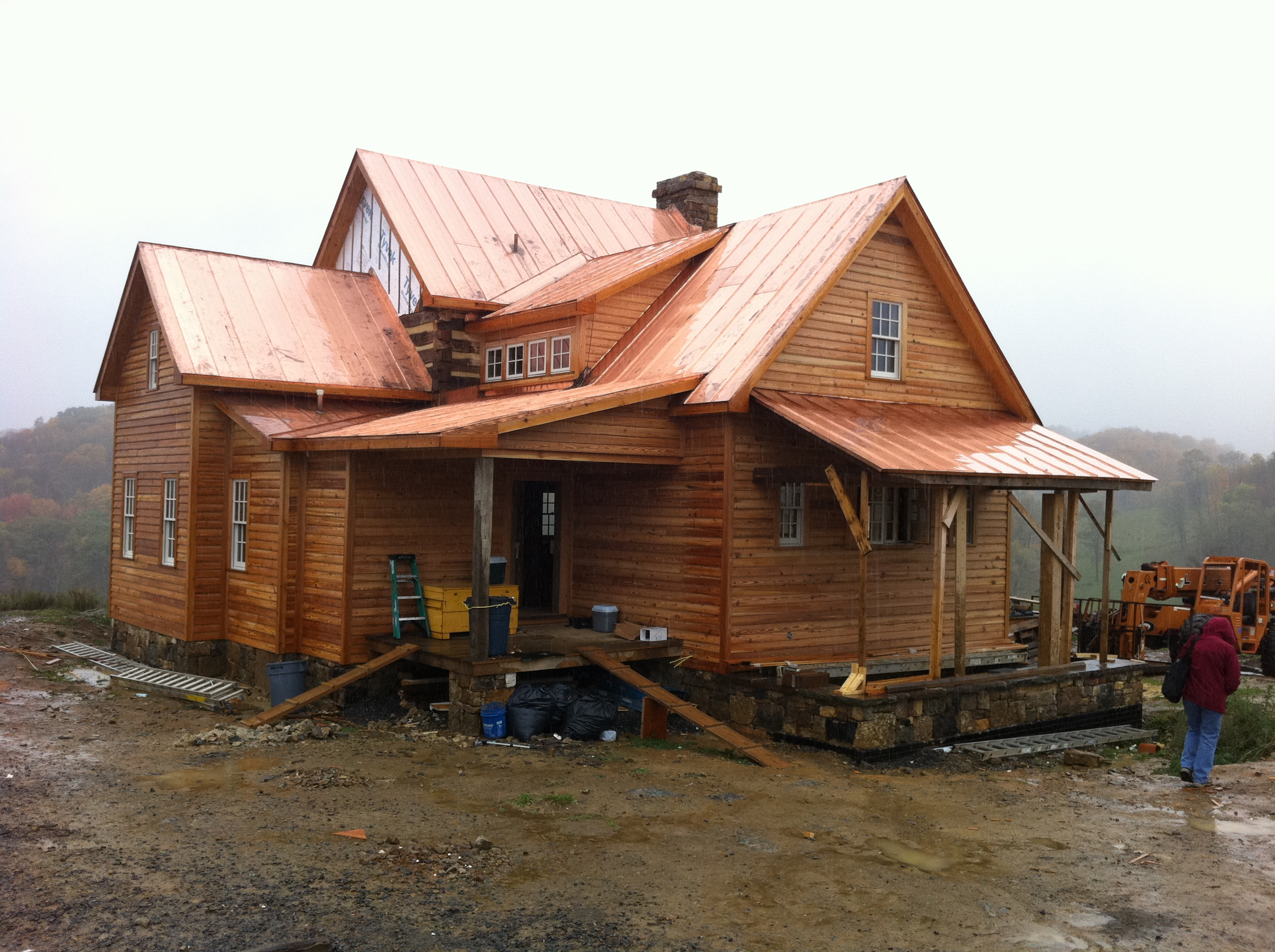 A copper roof from shiny to green handmade houses Log cabin for two